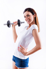 Smiling woman lifting weight