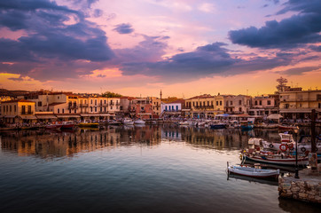 RETHYMNO, CRETE ISLAND, GREECE – JUNE 29, 2016: View of the old venetian port of Rethimno at sunset.