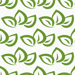 Repeated outlines of green leaves on white background. Seamless pattern.