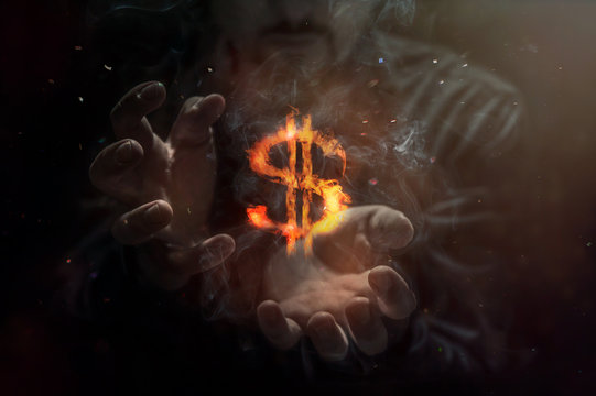 Burning symbol of dollar with man in background. Conception of risk management in money trading at currency market