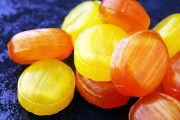Mixed colorful fruit candies. bonbon in yellow and orange