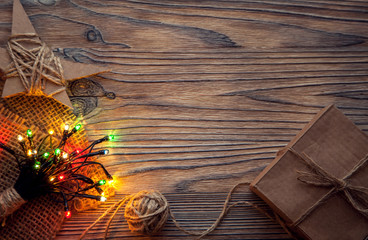 Christmas gift box and decorations on wooden background copy space for lettering top view