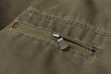 Element of clothing. Zipper closes pocket on clothes