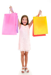 Adorable little girl child holding shopping colorful paper bags isolated