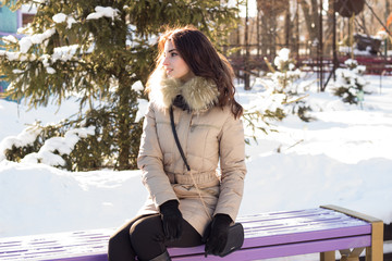 Young beauty woman in winter park