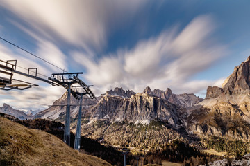 Upper station of the cable car, in the background Dolomites and clouds in motion. Dolomites Alps, Italy