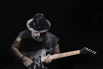 man with the guitar between chalk dust and smoke