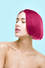Beautiful girl with pink hair on blue background