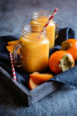 Persimmon smoothie in glass jars