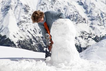 Girl snowman mountains