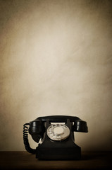 Viintage Black 1940s Telephone on Wood with Aged Effects