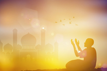 Silhouettes Muslim prayer the light of faith hope faith with Muslim mosque blurred background ,Concept of Islam is the religion