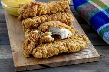 Fried chicken strips with variety of sauces