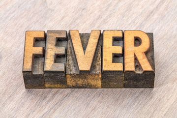 fever word abstract in wood type