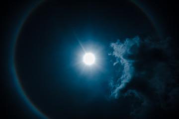 Moon halo phenomenon. Nighttime sky and bright full moon with shiny.