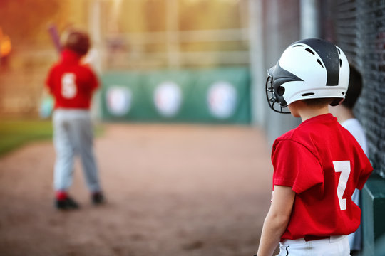 Youth Baseball player waiting on deck in batting line up