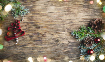 Christmas background. Christmas fir tree and decorations on wooden background,
