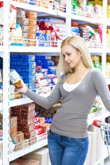 Portrait of a Woman Choosing a Product in a Supermarket