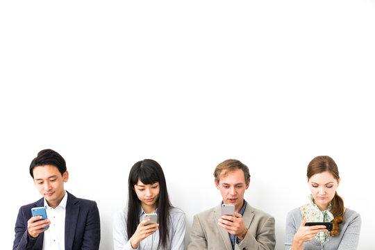 Group of people using smart phones.