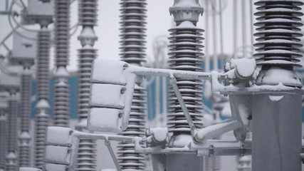 Switchgears and switches in a power plant with steel structure. Power plant detail, high voltage isolation. Voltage transformers at the power plant