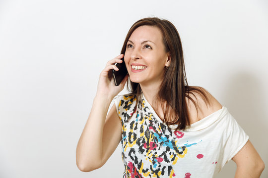 Beautiful happy smiling brown-haired woman talking on mobile phone on white background. Emotions concept.