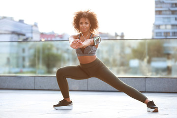 Sporty African American woman training outdoors