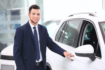 Car salesman in dealership
