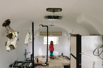 Girl looking out window in camper trailer