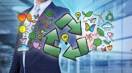 Businessman touching ecology interface with arrow recycling logo