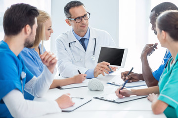 doctors having conversation and looking at tablet