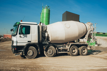 White concrete mixer vehicle on the construction site
