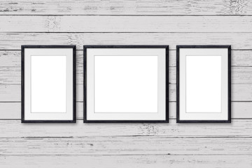 Black wooden frames on old painted wooden planks wall. Interior decor mock up
