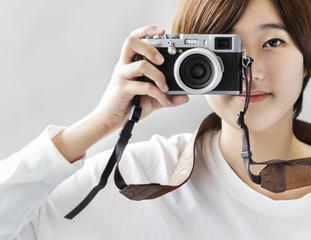 An Asian woman taking photographs