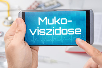 Smartphone mit dem Text Mukoviszidose auf dem Display