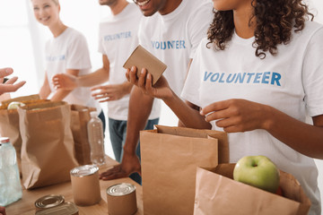 volunteers packing food and drinks for charity