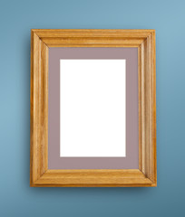 Mock up of blank photo frame on blue wall.