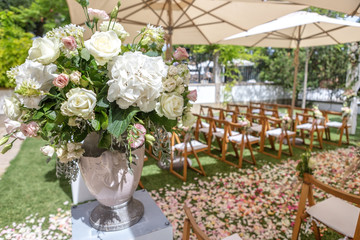 Details of wedding ceremony, flowers and petals for decoration.