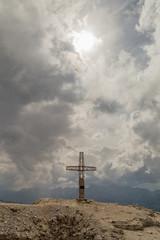 Fotomurales - cross on mauntain top. Passo Pordoi. Dolomites Alps. South Tyrol. Italy