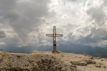 Wall Mural - cross on mauntain top. Passo Pordoi. Dolomites Alps. South Tyrol. Italy