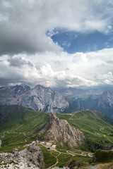 Fototapete - Cloudy day in Italian Dolomites Alps. Beautiful mauntain landscape. Passo Pordoi. South Tyrol. Italy