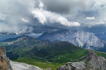 Wall Mural - Cloudy day in Italian Dolomites Alps. Beautiful mauntain landscape. Passo Pordoi. South Tyrol. Italy