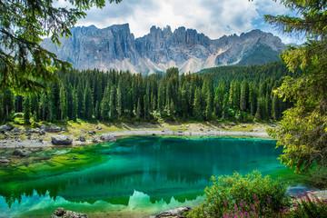 Carezza lake (Lago di Carezza, Karersee) in Dolomites Alps. South Tyrol. Italy Wall mural