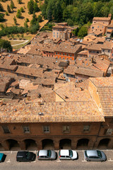 Urbino, Italy - August 9, 2017: the old city. roofs of houses under red tiles. view from above.