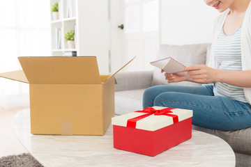 young elegant woman opening delivery parcel box