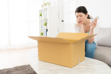 pretty woman opening online shopping parcel box