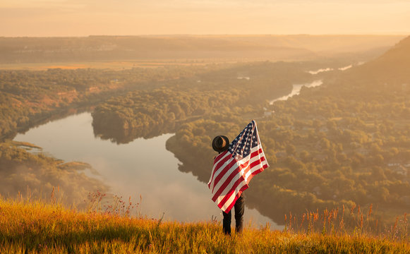 Man with USA flag in nature