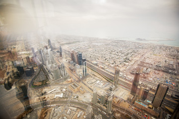 UAE aerial view of the wonderful cityscape and exotic style from the top of building through the window in Dubai.