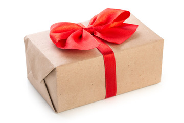 Gift box wrapped in kraft paper with red ribbon bow, isolated on white background