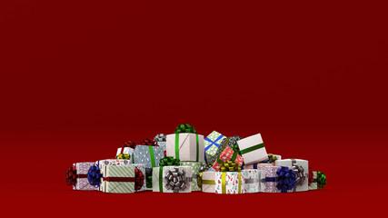 Geschenke zu Weihnachten vor rotem Hintergrund