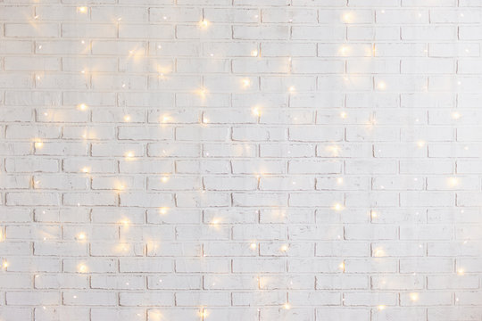 white brick wall background with shiny lights